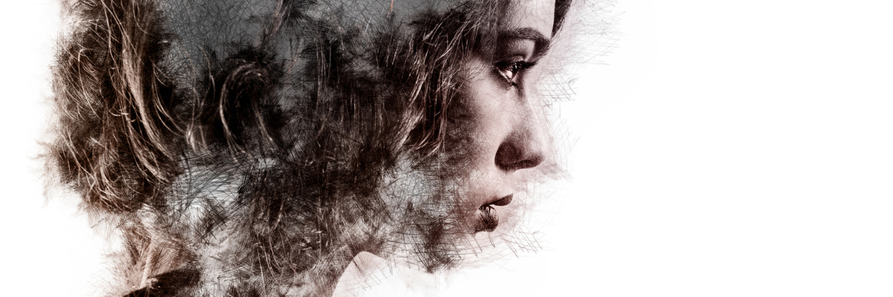 surreal portrait of woman double exposure with overlaid trees and branches