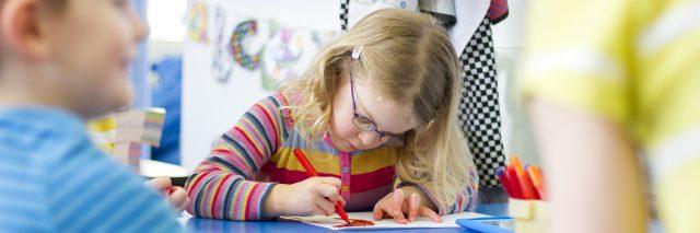 Girl writing in school.