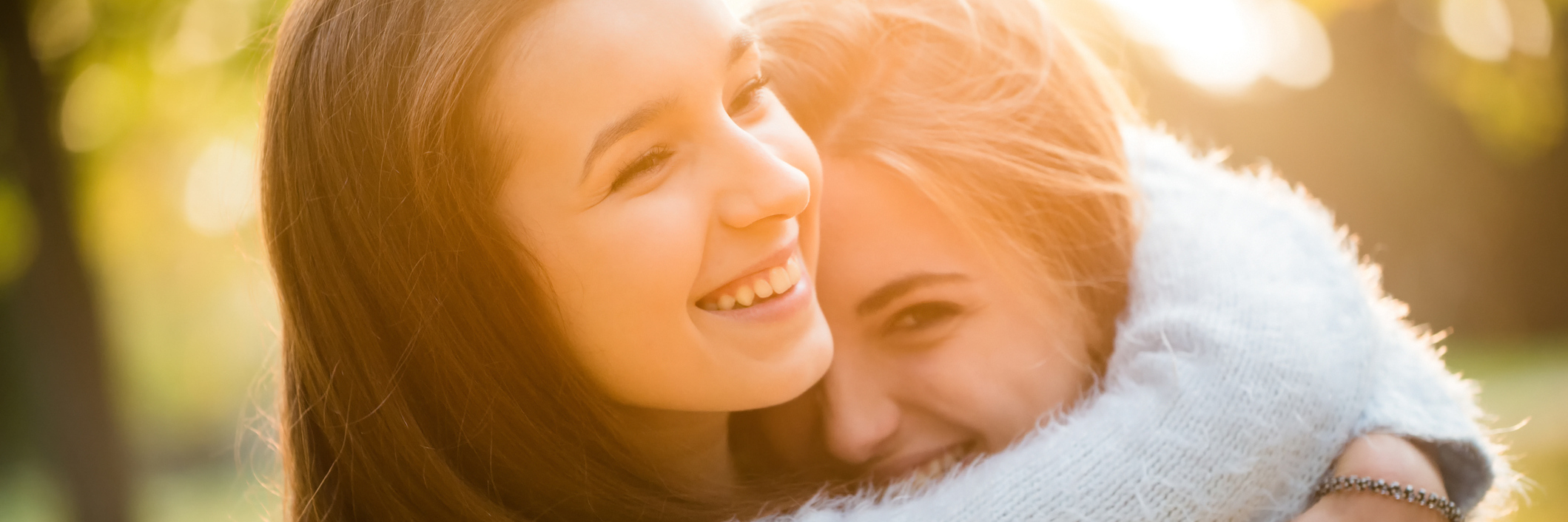 two friends hugging outdoors