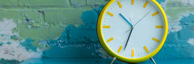Big yellow retro style alarm clock.