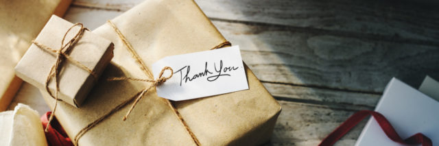 Gift wrapped in brown paper, tag says: thank you