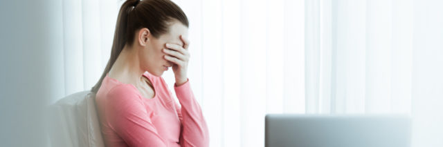 upset stressed businesswoman in office