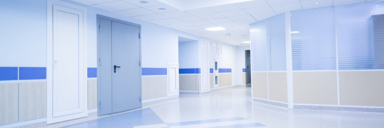 Corridor in hospital with carts illuminated by sunlight