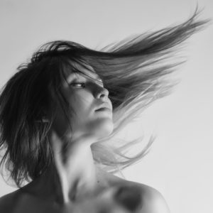 A woman with her hair blowing behind her