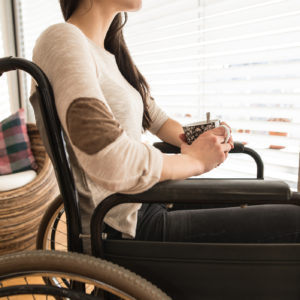 woman sitting in her wheelchair