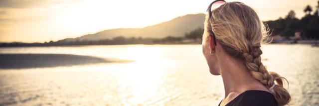 woman looking out at a lake