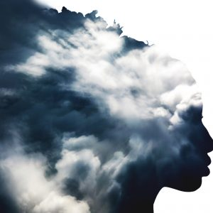 Double exposure of girl profile silhouette and stormy cloudscape