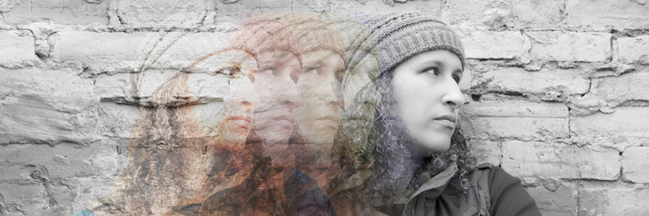 Multiple exposures of young woman standing with crossed arms against urban wall looking away, images from color fading