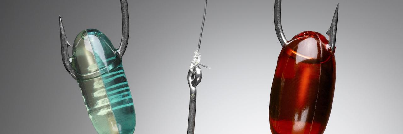 Capsules on fishing hooks
