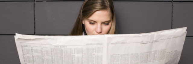 A woman reading the newspaper