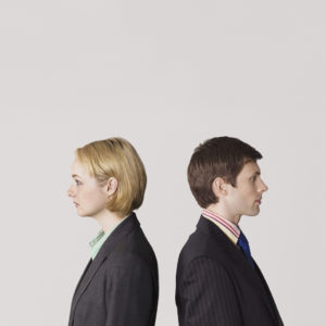 man and a woman with their backs facing each other