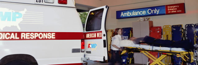 paramedics transporting a person from an ambulance to the hospital