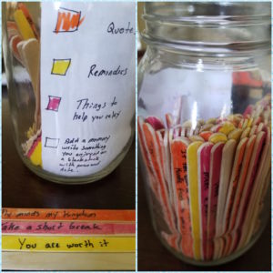 A jar with colorful popsicle sticks in it
