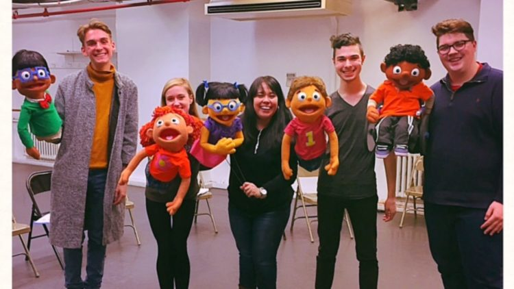 """Addy and Uno"" cast with their puppets"