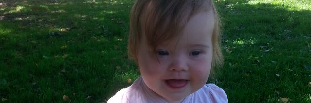 CLOSE-UP OF LITTLE GIRL WITH DOWN SYNDROME
