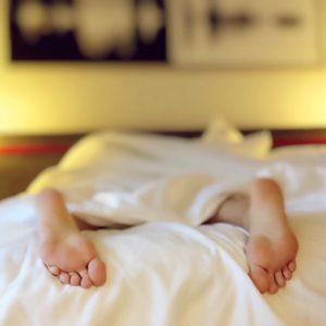 feet on bed sleeping