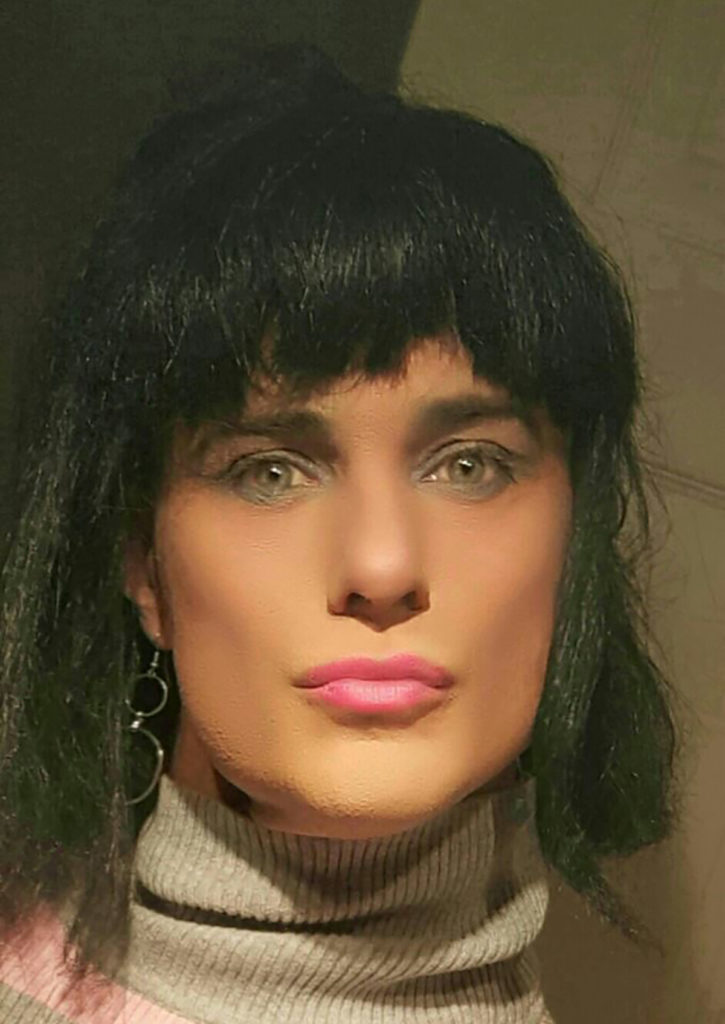 contributor's husband dressed as woman black wig makemakeup