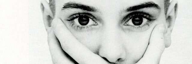 sinead oconnor covering her mouth with her hands