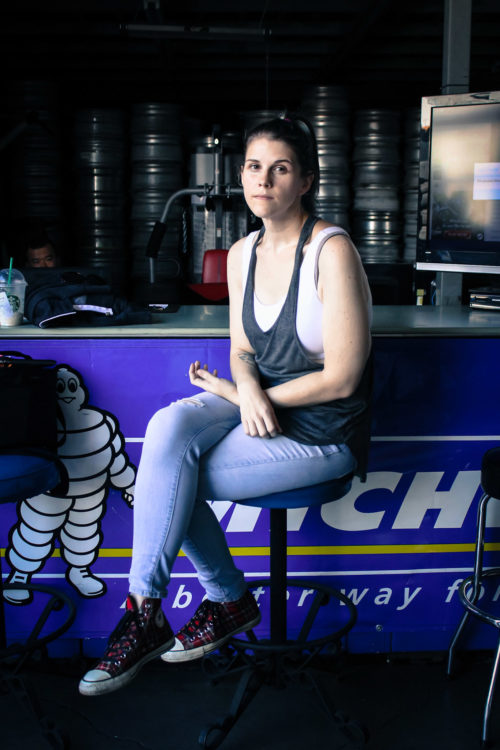 The writer sitting in a tire shop.