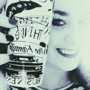 woman holding supernatural travel mug