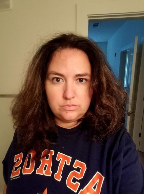 woman in t-shirt with unbrushed hair