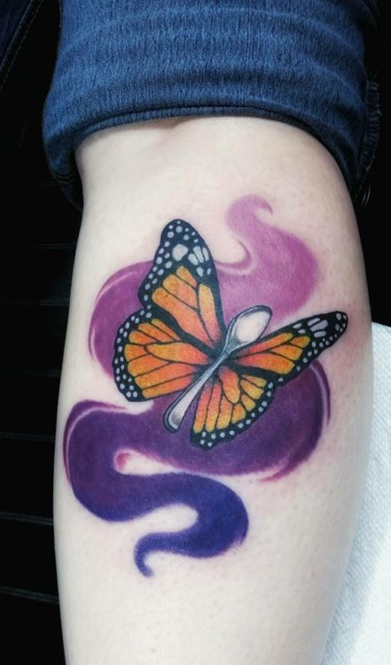 tattoo of a butterfly with a spoon