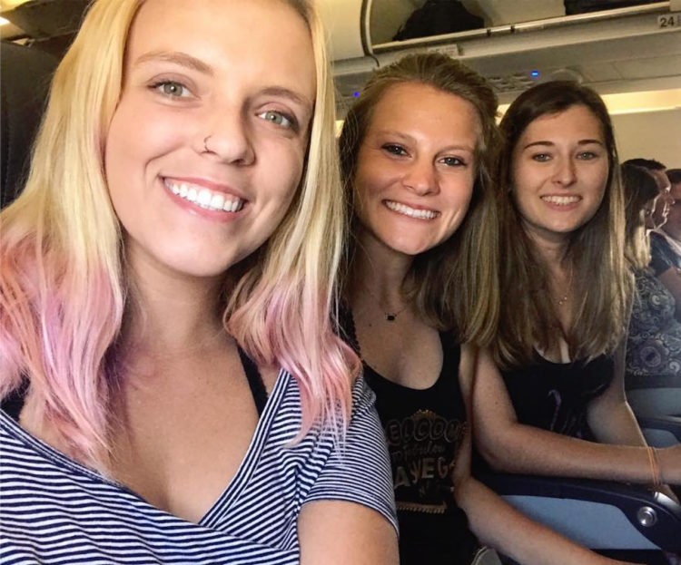 friends sitting on an airplane