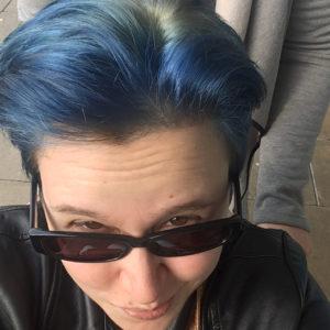 NA's blue hair.