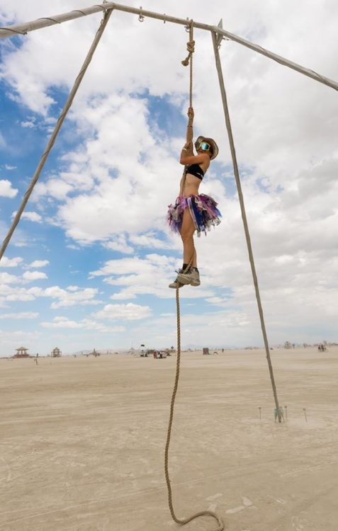 woman climbing on ropes at the beach