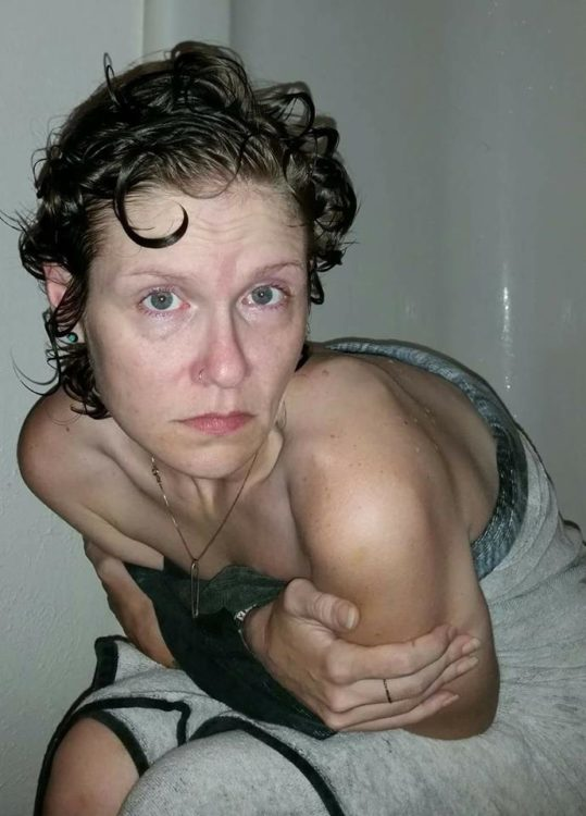 woman sitting down after taking a shower