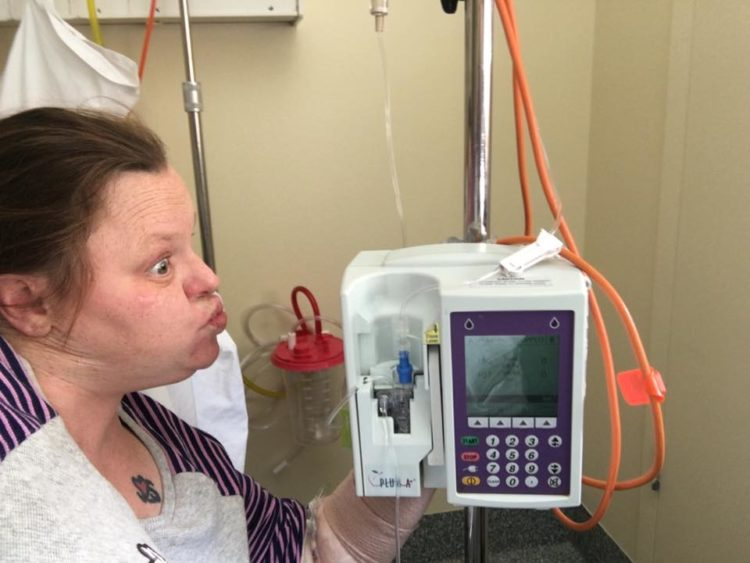 woman making a silly face at her monitor in the hospital