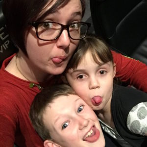 mother at the movie theater with two kids
