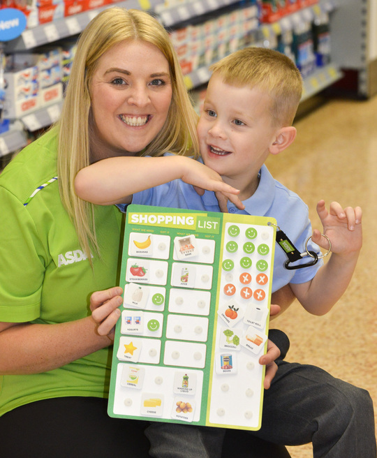 The Happy Little helpers scheme, which encourages young children to get involved with shopping, is being introduced into Asda stores next week. This picture shows Asda colleague Jenny Barnett who came up with the idea of the list with her five-year-old son Charlie