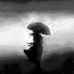 black and white image of a woman standing in the rain under an umbrella