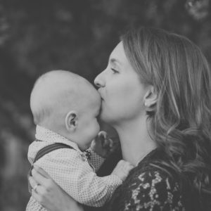 Mother kissing baby's head