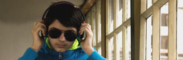 Young man wearing headphones.
