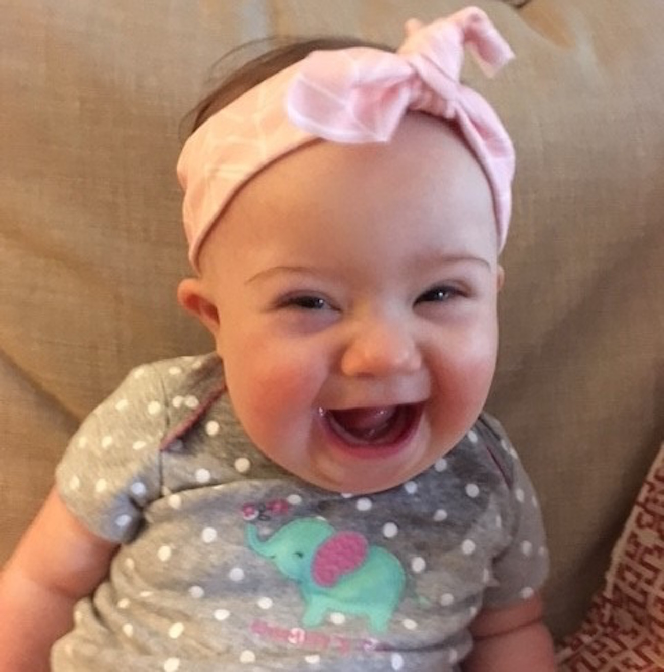 The author's daughter, smiling, wearing a headband