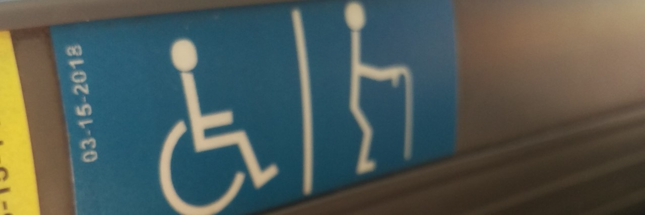 Disability sign showing a wheelchair user and cane user.
