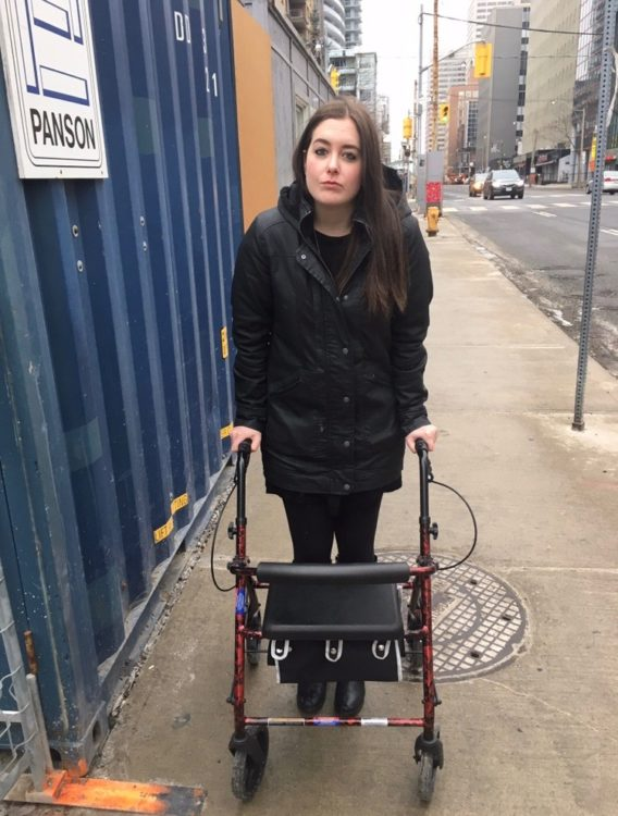 woman standing outside with her walker