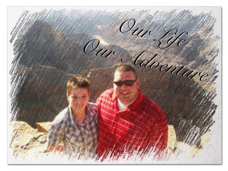 man and woman smiling at the grand canyon