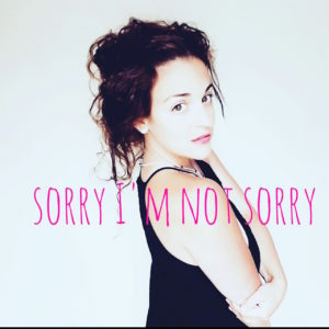 photo of kimberli with the text 'sorry I'm not sorry'
