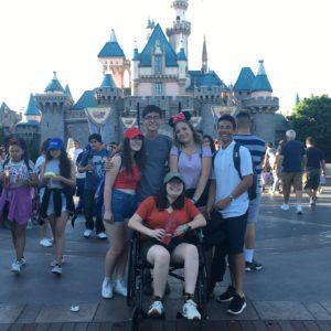 high school friends in front of disneyland castle