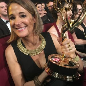 Casting Director Sasha Alpert holding her Emmy