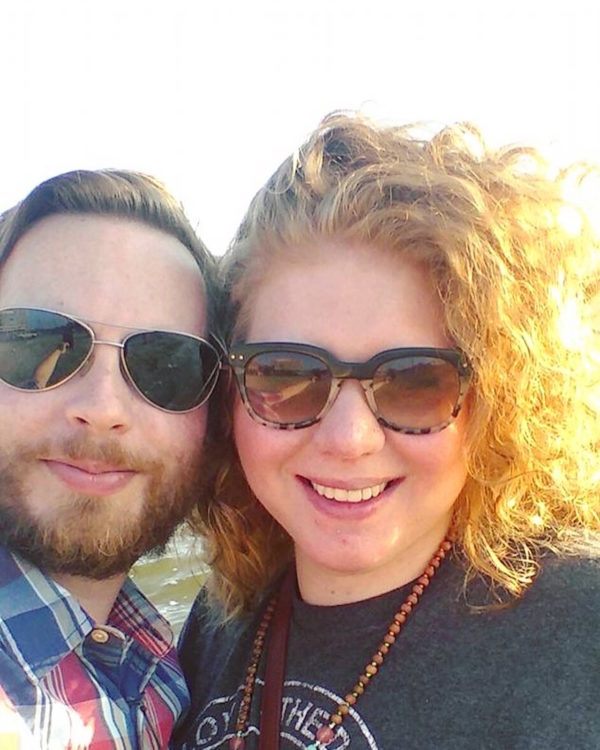 man and woman wearing sunglasses and smiling