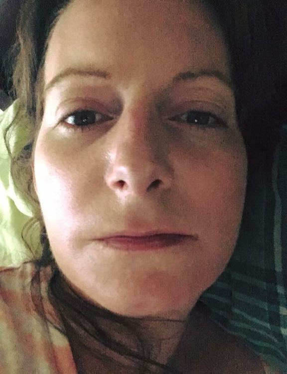 selfie of a woman with her mouth closed