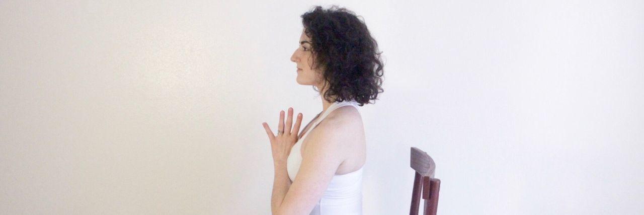 woman doing chair yoga pose