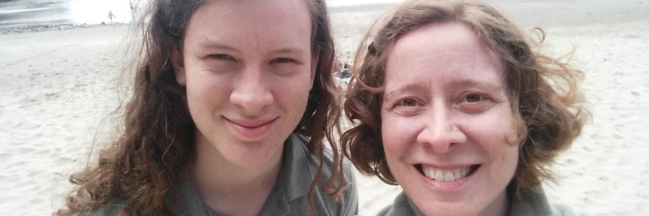woman and young man at beach