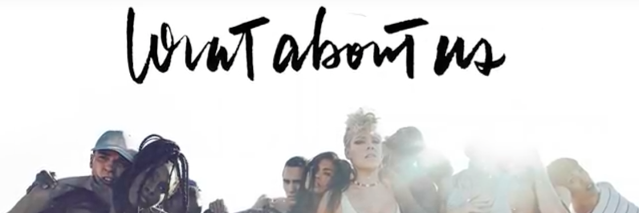 Image with singer P!nk and other people huddled together