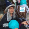 The author's son dressed as Albus Dumbledore, holding a teal pumpkin