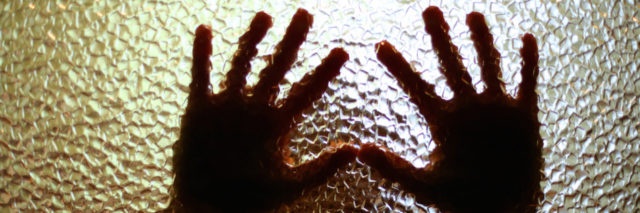 Hands over glass